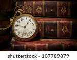 Old Clock Over Books Still Lif...
