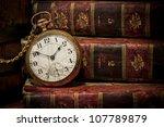 Old Clock Over Books Still Lif...