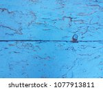 old paint blue wooden panels.... | Shutterstock . vector #1077913811