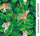 tropical leaves and tigers... | Shutterstock .eps vector #1077939497