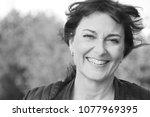 beautiful happy woman outside | Shutterstock . vector #1077969395