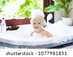 little child taking bubble bath ...   Shutterstock . vector #1077981851