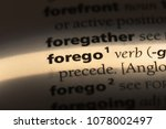 Small photo of forego word in a dictionary. forego concept