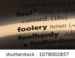 Small photo of foolery word in a dictionary. foolery concept
