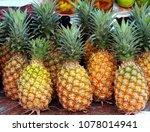Fresh Ripe Pineapples Are Sold...