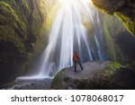 man looking at the gljufrabui... | Shutterstock . vector #1078068017