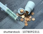 Cash Infusion  A Syringe With ...