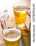cold golden chilled glass of... | Shutterstock . vector #1078094144