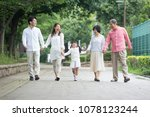 japanese family walk in the park | Shutterstock . vector #1078123244