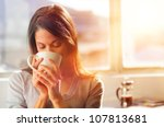 woman drinking coffee at home... | Shutterstock . vector #107813681