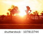 Silhouette Of A Woman Athlete...