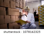 young focused female worker is... | Shutterstock . vector #1078162325