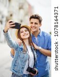 happy tourists taking selfie on ... | Shutterstock . vector #1078164371