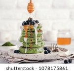 green pancakes with matcha tea  ... | Shutterstock . vector #1078175861
