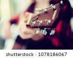 girl holding guitar in music... | Shutterstock . vector #1078186067
