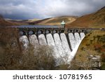 Craig Goch reservoir full and with water overflowing,  Elan Valley, Wales. - stock photo