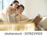 happy elderly woman watching a...   Shutterstock . vector #1078219505