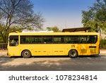Three Yellow Buses Waiting  ...
