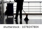Silhouette Image Of Cleaning...