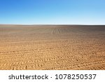 a field of plowed ground on a... | Shutterstock . vector #1078250537