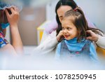 a little girl is curing a tooth ...   Shutterstock . vector #1078250945