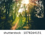 cyclist rides along country... | Shutterstock . vector #1078264151