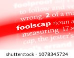 Small photo of foolscap word in a dictionary. foolscap concept