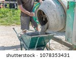 A Bricklayer Works With A...