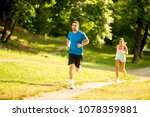 young couple running in the... | Shutterstock . vector #1078359881