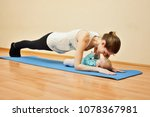 young mother does physical yoga ... | Shutterstock . vector #1078367981