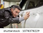 smiling man touches surface of... | Shutterstock . vector #1078378229