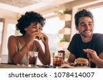 young woman with friends eating ... | Shutterstock . vector #1078414007