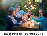 one summer evening  friends in... | Shutterstock . vector #1078551041
