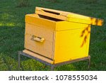 Yellow Wooden Beehive On A...