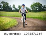 smiling girl ride on bike on... | Shutterstock . vector #1078571369