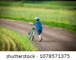 little boy walking with his... | Shutterstock . vector #1078571375