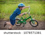 little boy running with his... | Shutterstock . vector #1078571381