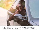 African Man Wearing Sunglasses...