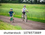 two kids riding on bikes... | Shutterstock . vector #1078573889