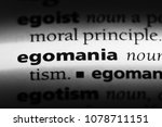Small photo of egomania word in a dictionary. egomania concept