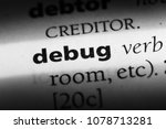 Small photo of debug word in a dictionary. debug concept