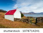 a pretty cottage with a red tin ... | Shutterstock . vector #1078714241