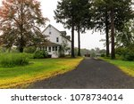 long driveway to large rural... | Shutterstock . vector #1078734014