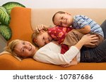 Happy woman and kids having fun indoors - stock photo