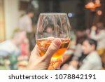 a girl's hand holds a glass... | Shutterstock . vector #1078842191
