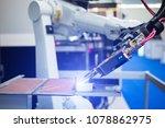 automatic welding robot in a... | Shutterstock . vector #1078862975