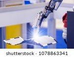 automatic welding robot in a... | Shutterstock . vector #1078863341