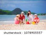 family making sand castle at... | Shutterstock . vector #1078905557