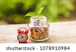 red alarm clock with coin in... | Shutterstock . vector #1078910984