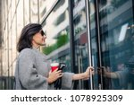 smiling woman entering in... | Shutterstock . vector #1078925309